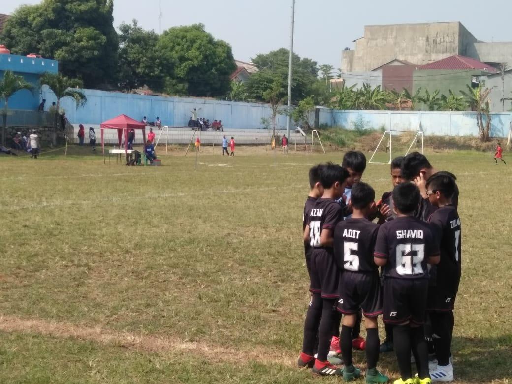 ampak Tim sepak bola U-12 yang mengikuti Kompetisi liga Aqua Danone Nations Cup (DNC) di Stadion Mini Ciputat, Jalan Pendidikan, Ciputat, Tangsel, Sabtu (22/6/2019).